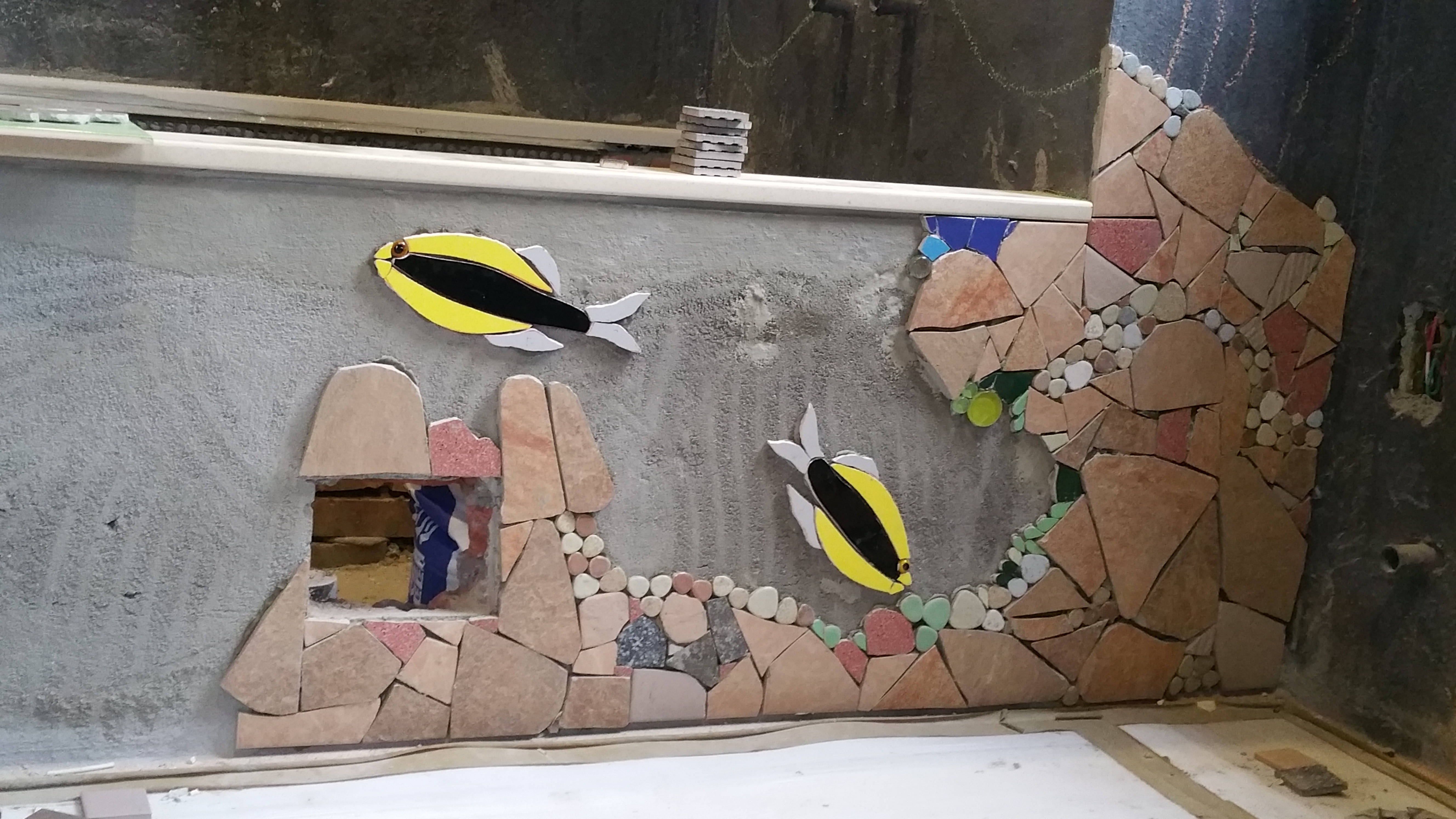 First fish and rocks direct on the wall. Coloured tile and VERY HARD rock tiles